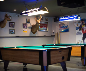 Full bar with Pool Tables